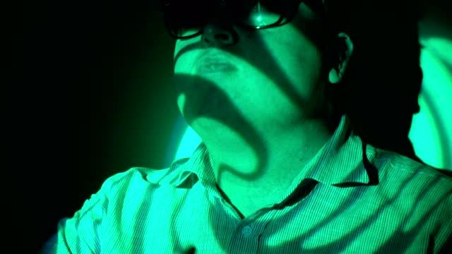 Portrait-of-a-fat-man-in-a-multicolored-light-beam-