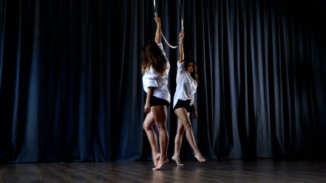 Two-girls-are-dancing-with-aerial-hoop-on-stage