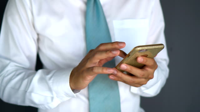 CU---Businessman-playing-his-phone