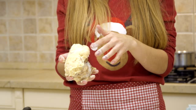 Woman-kneads-dough-for-cookies