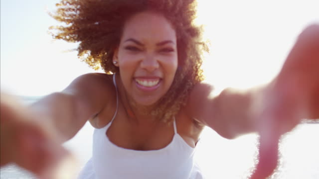 Portrait-of-African-American-female-laughing-to-camera
