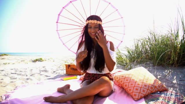 Portrait-of-Indian-American-girl-at-beach-picnic