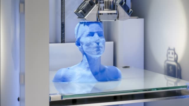 3D-printer-at-work-3D-printing-a-human-bust---symbol-for-industrial-revolution