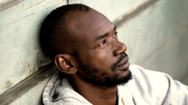 depressed-sad-black-african-migrant-looking-in-camera-outdoor