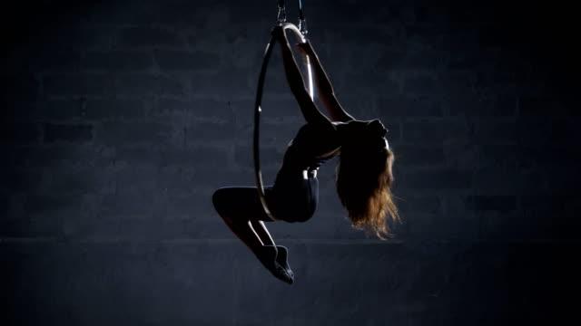 Pretty-girl-hangs-upside-down-on-the-aerial-hoop