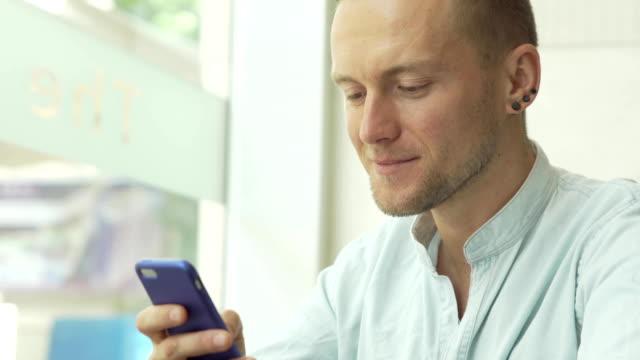 Man-using-app-on-smartphone