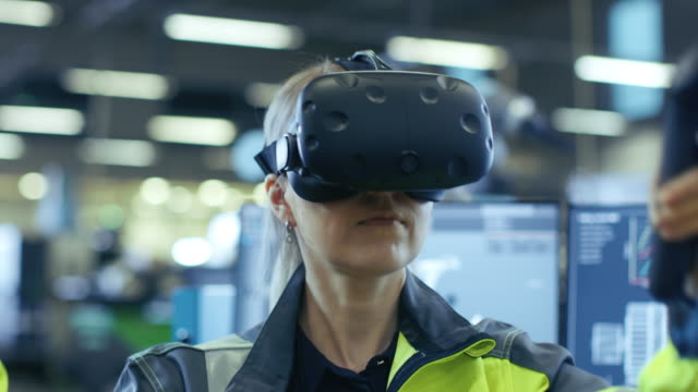 Portrait-Female-Mechanical-Engineer-Wearing-Virtual-Reality-Headset-and-Using-Controllers-She-Uses-VR-technology-for-Industrial-Design-Development-and-Prototyping-in-CAD-Software-
