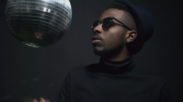 Male-Rapper-Spinning-Disco-Ball-and-Smoking