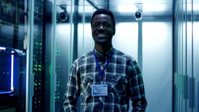 Smiling-black-man-in-server-room