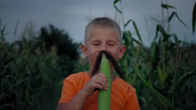 A-boy-with-corn-silk-mustache-Boy-making-a-mustache-from-corn-hair
