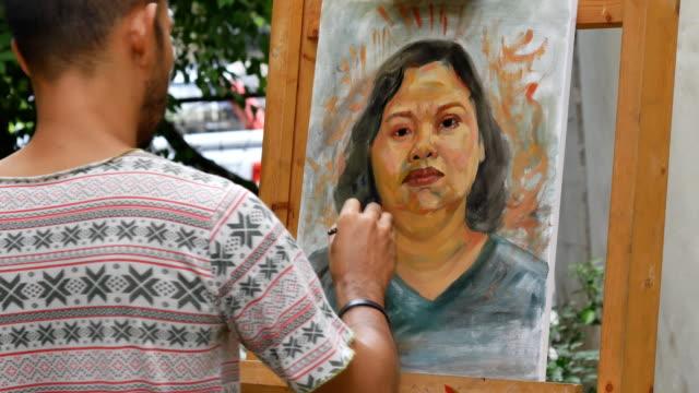 Artist-painting-portrait-of-asian-woman