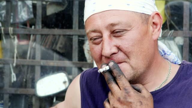 A-Working-Man-Lit-a-Cigarette