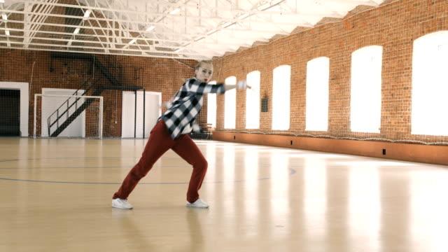 B-girl-dancing-breakdance-in-sport-gym