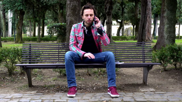 man-receives-a-phone-call-and-despair-tears-outdoor