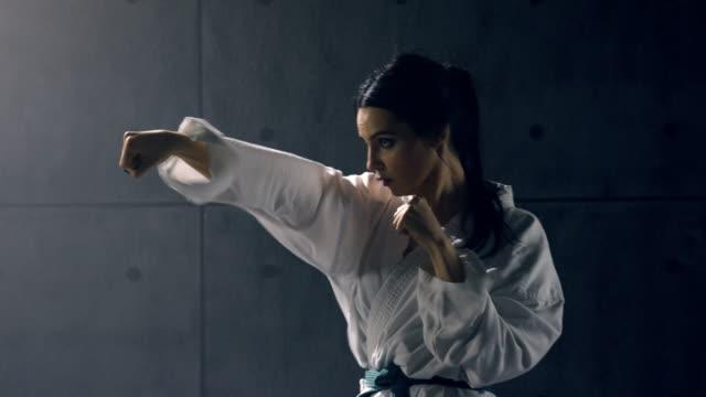 Young-woman-in-kimono-practicing-karate
