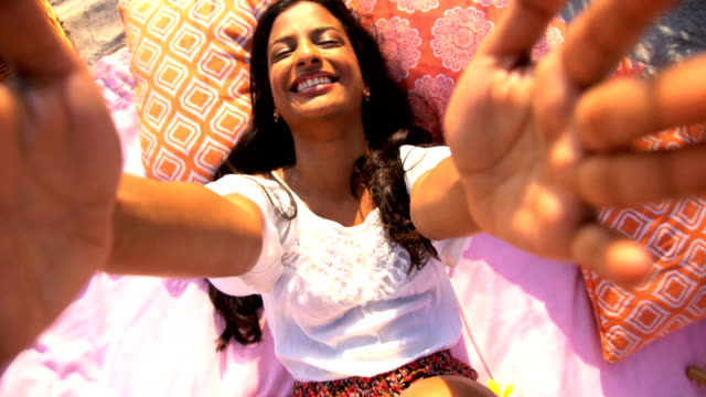 Portrait-of-Asian-Indian-female-picnic-video-diary