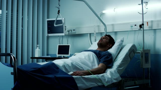 Terminally-Ill-Male-Patient-Lies-on-a-Bad-In-the-Hospital-Melancholy-and-Exhausted-Patient-in-the-Palliative-Care-Ward-