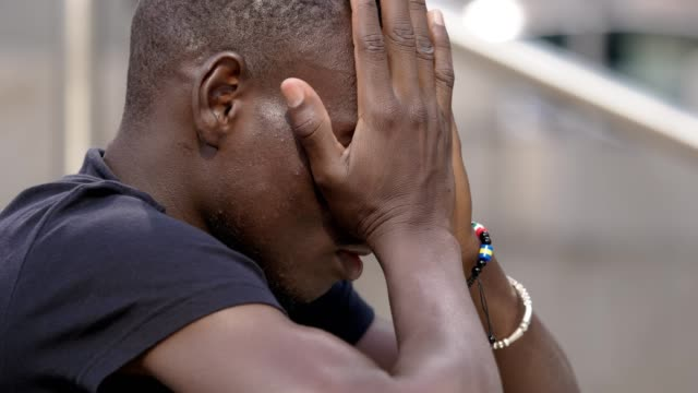 Sad-young-black-african-praying-Loneliness-desperation-hope