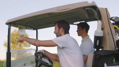 Close-up-of-golf-cart-and-riders