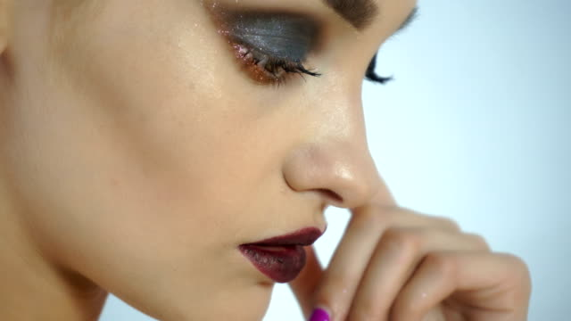 Close-up-of-beautiful-young-girl-with-make-up-and-healthy-skin