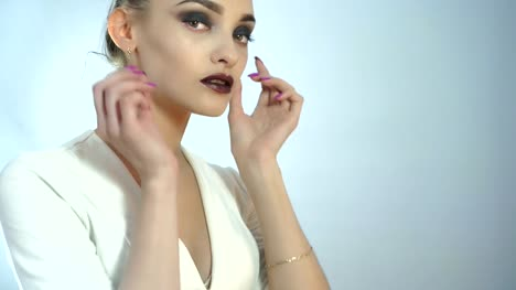 Glamrou-young-girl-with-beautiful-make-up-and-healthy-skin-posing-on-camera