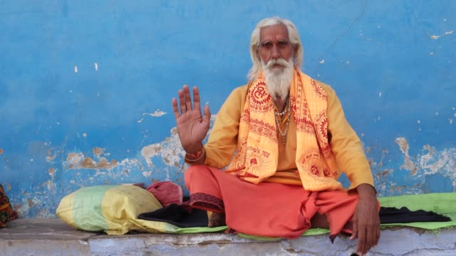 Sadhu-baba-Indian-holy-man-giving-blessings-with-his-right-hand-raised-in-Pushkar-Rajasthan