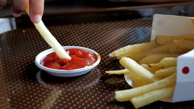 Close-up-Hand-of-little-asians-boy-enjoy-eating-french-fries-and-ketchup-video-Slow-motion