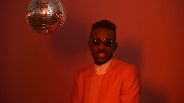 Guy-with-Disco-Ball-Partying-on-Pink-Background