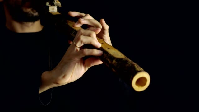 man-playing-the-flute