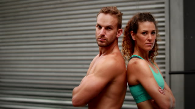 Fit-couple-posing-at-gym-gym