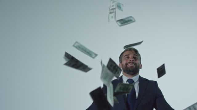 Happy-Businessman-Throwing-Money-in-Air