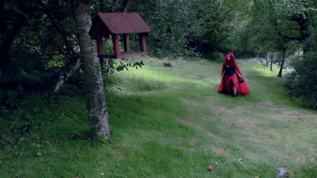 4k-Halloween-Shot-of-Red-Riding-Hood-Walking-in-the-Forest