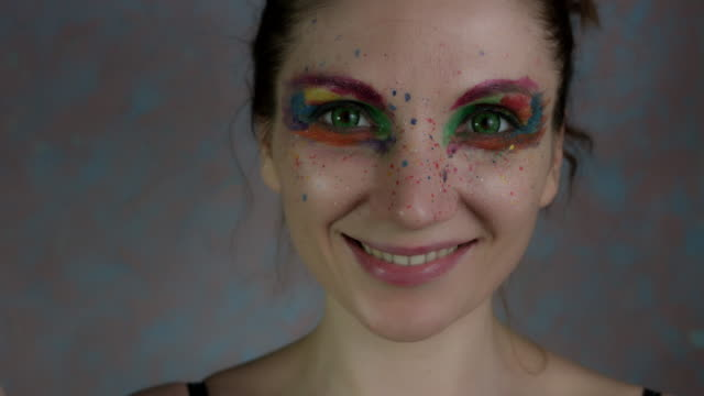4k-Shot-of-a-Woman-with-Multicoloured-Make-up-with-Pomegranate