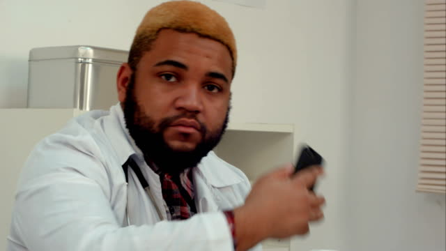 African-American-doctor-making-a-phone-call-in-the-office