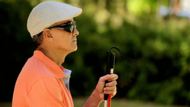 Portrait-Of-Blind-Man-Sitting-In-City-Park