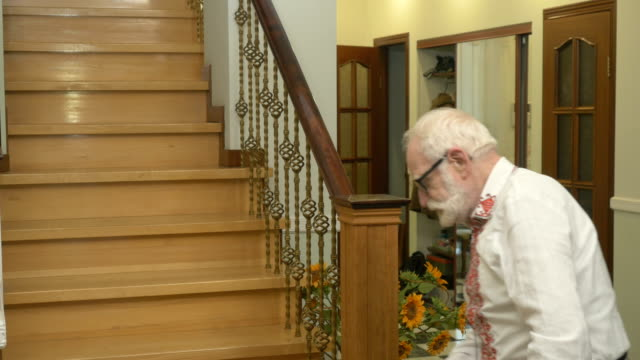 Kind-old-man-leaning-on-the-cone-walks-upstairs