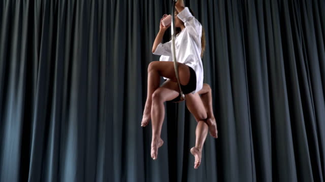 Pretty-girls-spins-in-the-aerial-hoop-and-drinks-water