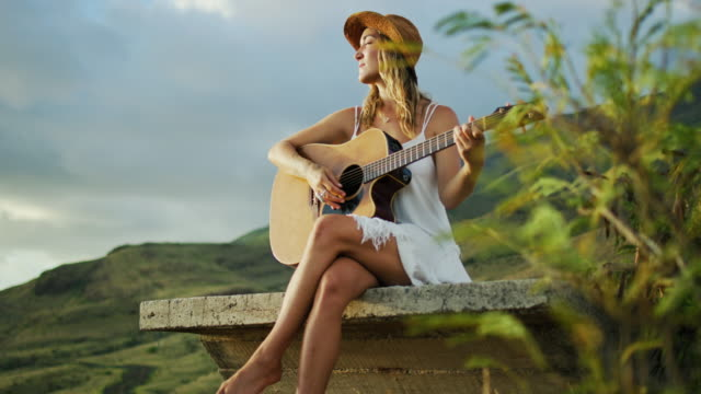 Young-Woman-Playing-Guitar