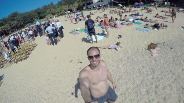 Man-taking-a-selfie-in-a-Beach-in-Sydney-Australia