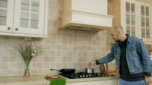 Man-makes-a-smaller-fire-on-the-stove-for-soup