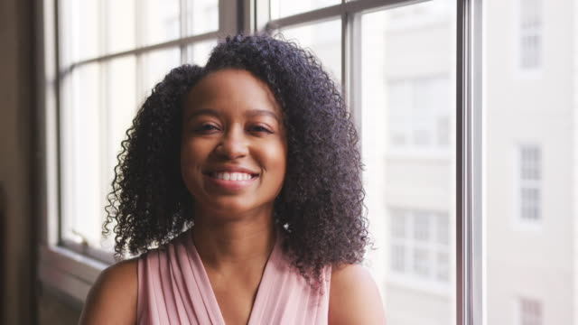 Young-black-businesswoman-smiling-to-camera-close-up