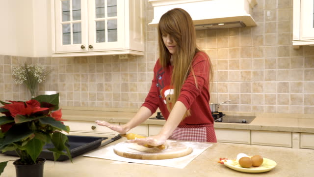 Girl-rolls-a-dough-with-a-rolling-pin