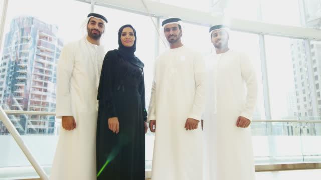 Portrait-male-female-Arabic-business-team-national-dress