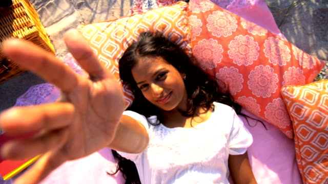 Portrait-of-Indian-American-female-picnic-on-beach