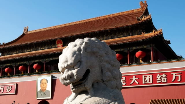 close-up-of-a-stone-lion-at-the-entrance-to-the-forbidden-city