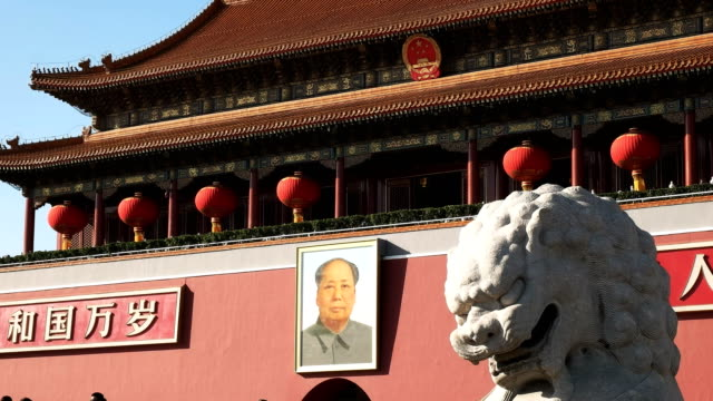 ancient-stone-lion-and-mao-zedong-portrait-in-tiananmen-square-china
