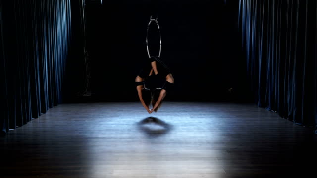 Charming-acrobats-performs-a-trick-in-the-aerial-hoop