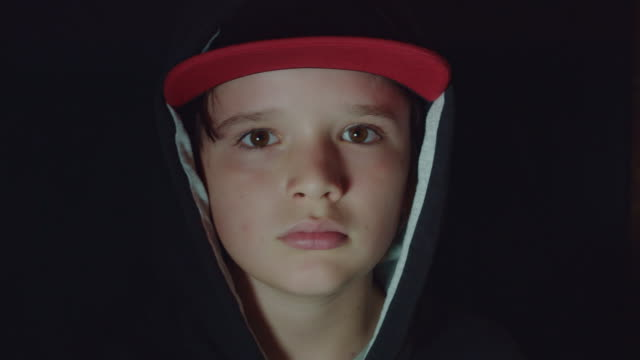 4k-Face-Portrait-of-Boy-Child-Posing-Serious-and-Sad