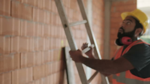 Portrait-Of-Happy-Hispanic-Worker-Smiling-In-Construction-Site