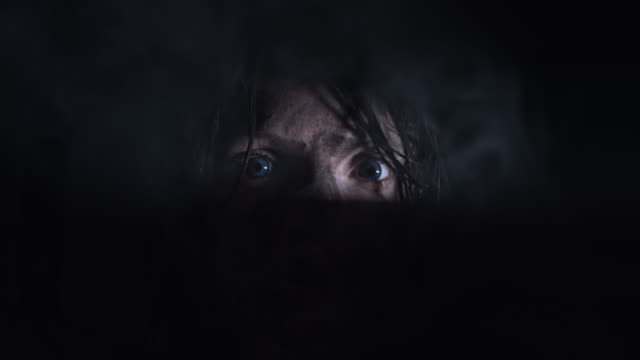 4k-Horror-Shot-of-a-Dirty-Zombie-Woman-Looking-Through-a-Hole